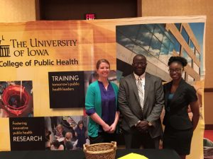 Group standing in front of College Health sign