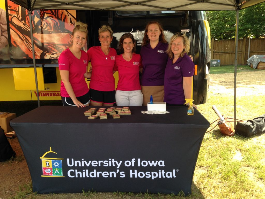 A team from UI Stead Family Children's Hospital and UI IPRC does outreach at the Iowa State Fair.