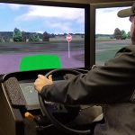 Driver in a driving tractor simulator