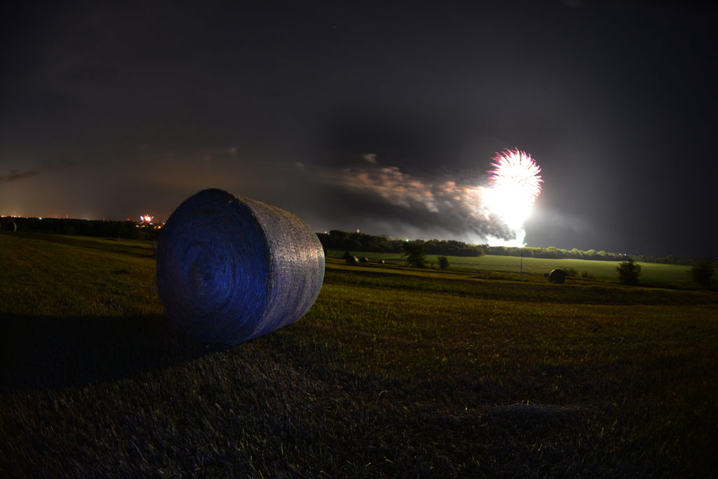 small town fireworks from the pasture hill